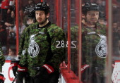 Matt Kassian of the Ottawa Senators warms up wearing a special camouflage jersey on Canadian Forces Appreciation Night prior to a game against the...