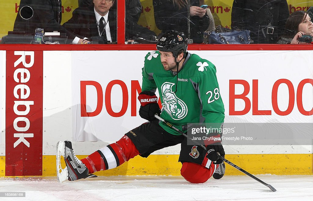 Matt Kassian #28 of the Ottawa Senators wears a special green warm-up jersey to celebrate Saint Patrick's Day, prior to a game against the Winnipeg Jets, during an NHL game at Scotiabank Place, on March 17, 2013 in Ottawa, Ontario, Canada.