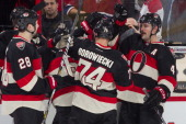 Matt KassianMark Borowiecki and Chris Phillips of the Ottawa Senators hive five each other following their win during an NHL game against the...