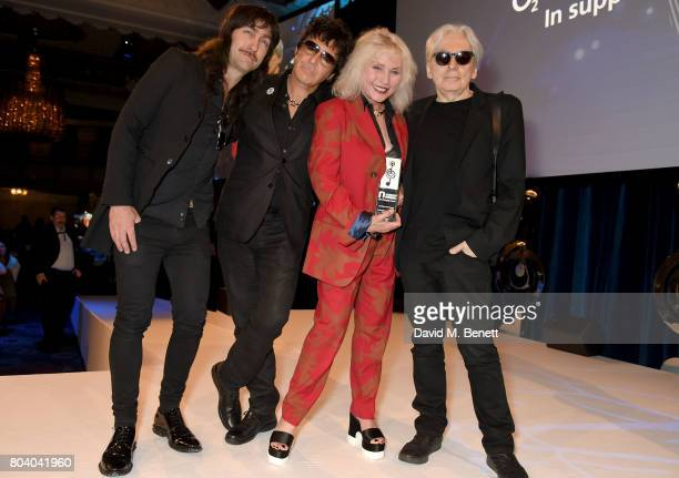 Matt KatzBohen Clem Burke Debbie Harry and Chris Stein of Blondie with their Amazon Outstanding Achievement Award at the Nordoff Robbins O2 Silver...