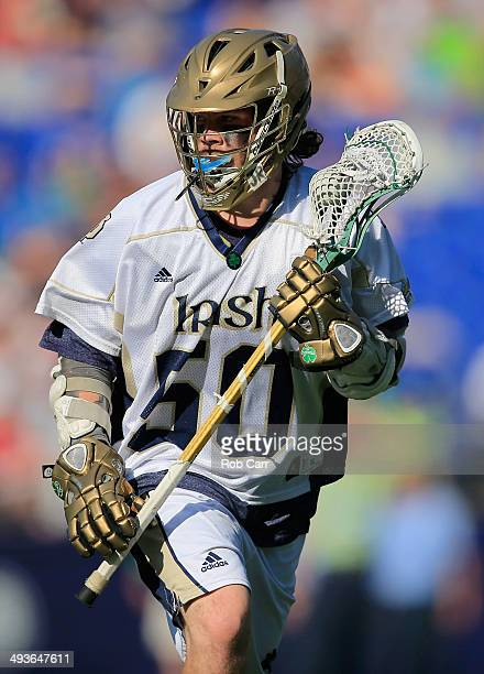 Matt Kavanagh of the Notre Dame Fighting Irish cradles the ball while looking to pass against the Maryland Terrapins in the second half during the...