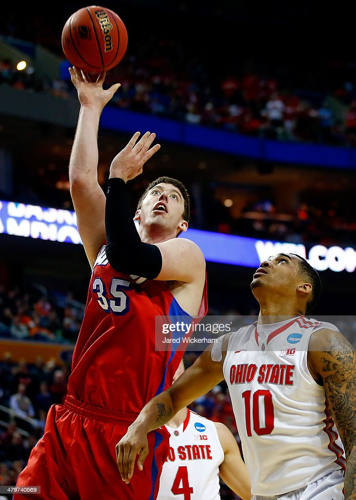 Matt Kavanaugh of the Dayton Flyers goes up for a shot against LaQuinton Ross of the Ohio State Buckeyes during the second round of the 2014 NCAA...