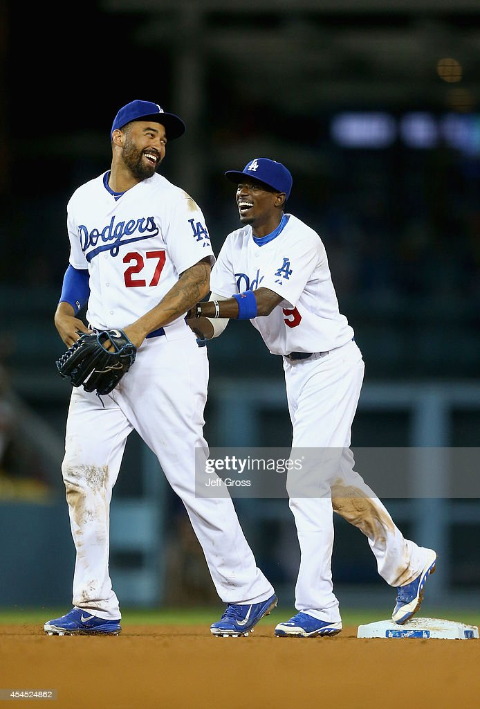 <a gi-track='captionPersonalityLinkClicked' href=/galleries/search?phrase=Matt+Kemp&family=editorial&specificpeople=567161 ng-click='$event.stopPropagation()'>Matt Kemp</a> #27 and <a gi-track='captionPersonalityLinkClicked' href=/galleries/search?phrase=Dee+Gordon&family=editorial&specificpeople=7091343 ng-click='$event.stopPropagation()'>Dee Gordon</a> #9 of the Los Angeles Dodgers celebrate the Dodgers' 4-1 victory over the Washington Nationals at Dodger Stadium on September 2, 2014 in Los Angeles, California.
