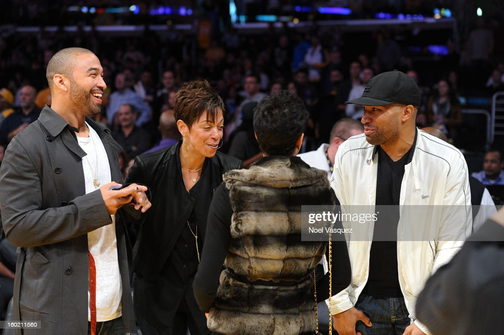 Matt Kemp (L) and Derek Fisher attend a basketball game between the Oklahoma City Thunder and the Los Angeles Lakers at Staples Center on January 27, 2013 in Los Angeles, California.