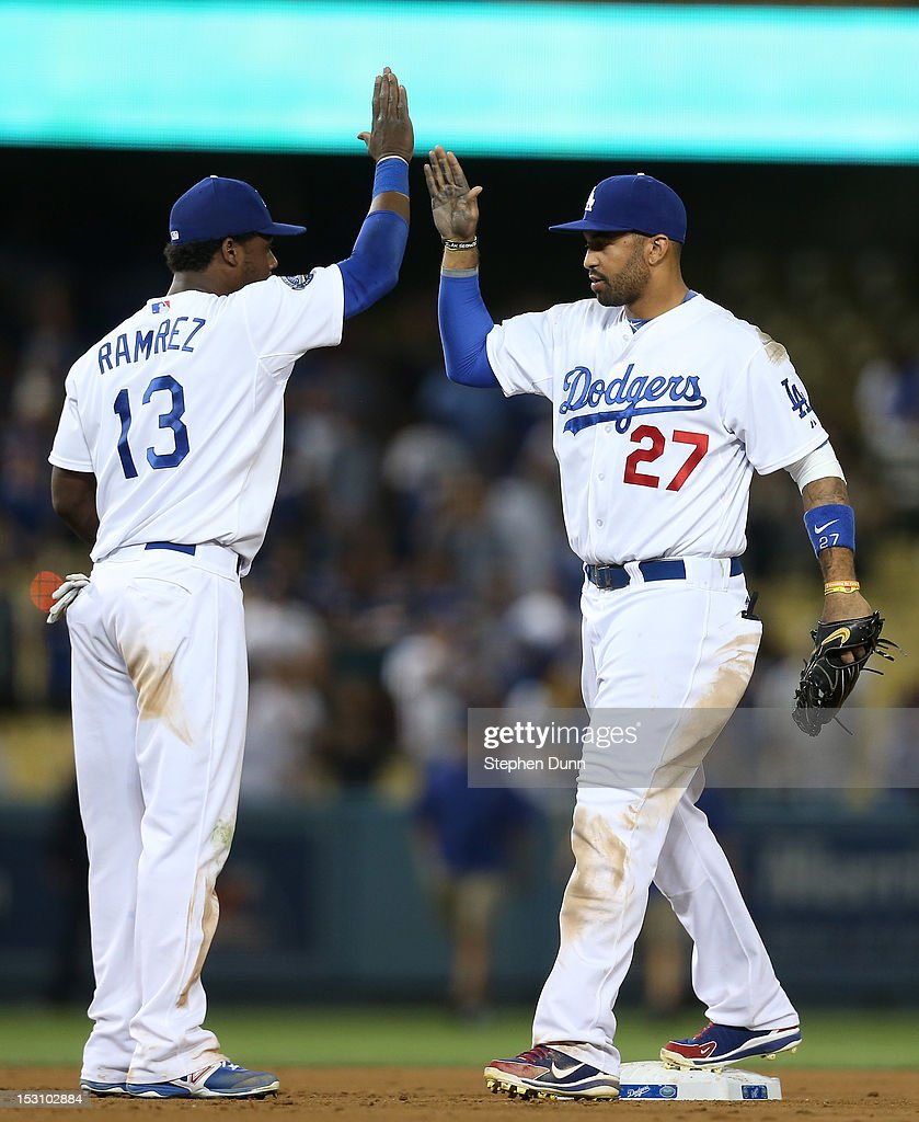 <a gi-track='captionPersonalityLinkClicked' href=/galleries/search?phrase=Matt+Kemp&family=editorial&specificpeople=567161 ng-click='$event.stopPropagation()'>Matt Kemp</a> #27 and <a gi-track='captionPersonalityLinkClicked' href=/galleries/search?phrase=Hanley+Ramirez&family=editorial&specificpeople=538406 ng-click='$event.stopPropagation()'>Hanley Ramirez</a> #13 of the Los Angeles Dodgers celebrate after the game against the Colorado Rockies on September 29, 2012 at Dodger Stadium in Los Angeles, California.