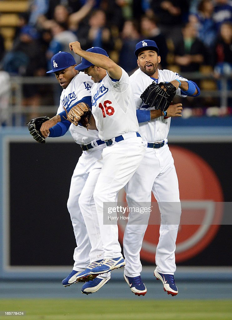 Matt Kemp #27, Carl Crawford #25 and Andre Ethier #16 of the Los Angeles Dodgers celebrate a 3-0 win over the Pittsburgh Pirates at Dodger Stadium on April 5, 2013 in Los Angeles, California.