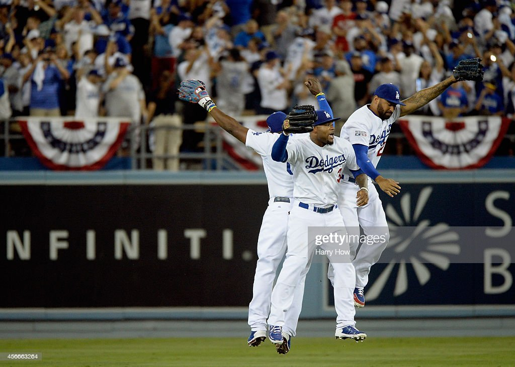 <a gi-track='captionPersonalityLinkClicked' href=/galleries/search?phrase=Matt+Kemp&family=editorial&specificpeople=567161 ng-click='$event.stopPropagation()'>Matt Kemp</a> #27, <a gi-track='captionPersonalityLinkClicked' href=/galleries/search?phrase=Carl+Crawford&family=editorial&specificpeople=208074 ng-click='$event.stopPropagation()'>Carl Crawford</a> #3 and <a gi-track='captionPersonalityLinkClicked' href=/galleries/search?phrase=Yasiel+Puig&family=editorial&specificpeople=10484087 ng-click='$event.stopPropagation()'>Yasiel Puig</a> #66 of the Los Angeles Dodgers celebrates their team's 3-2 win over the St. Louis Cardinals in Game Two of the National League Division Series at Dodger Stadium on October 4, 2014 in Los Angeles, California.