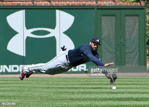 Matt Kemp of the Atlanta Braves can't make a catch on a single hit by Ian Happ of the Chicago Cubs during the fifth inning on September 3 2017 at...