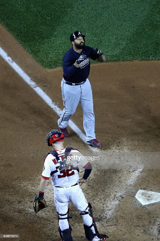 Matt Kemp #27 of the Atlanta Braves celebrates in front of catcher Matt Wieters #32 of the Washington Nationals after hitting a grand slam in the seventh inning at Nationals Park on September 13, 2017 in Washington, DC.