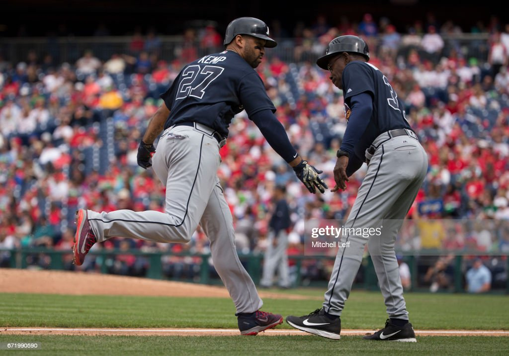 Matt Kemp #27 of the Atlanta Braves celebrates with third base coach Ron Washington #37 after hitting a solo home run in the top of the seventh inning against the Philadelphia Phillies at Citizens Bank Park on April 23, 2017 in Philadelphia, Pennsylvania. The Phillies defeated the Braves 5-2.