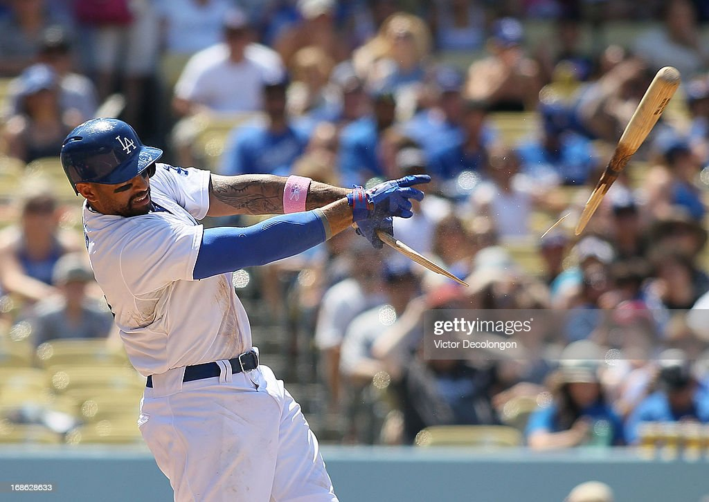 <a gi-track='captionPersonalityLinkClicked' href=/galleries/search?phrase=Matt+Kemp&family=editorial&specificpeople=567161 ng-click='$event.stopPropagation()'>Matt Kemp</a> #27 of the Los Angeles Dodgers breaks his bat on a single to center in the fifth inning during the MLB game against the Miami Marlins at Dodger Stadium on May 12, 2013 in Los Angeles, California. The hit was Kemp's 1000th hit. The Dodgers defeated the Marlins 5-3.