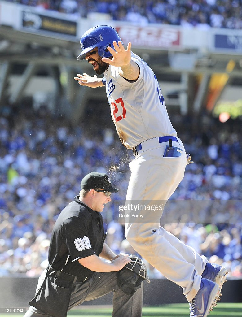 <a gi-track='captionPersonalityLinkClicked' href=/galleries/search?phrase=Matt+Kemp&family=editorial&specificpeople=567161 ng-click='$event.stopPropagation()'>Matt Kemp</a> #27 of the Los Angeles Dodgers celebrates after scoring ahead of the tag of Jesse Hahn #45 of the San Diego Padres during the eighth inning of a baseball game at Petco Park August, 31, 2014 in San Diego, California. Kemp scored on a wild pitch.