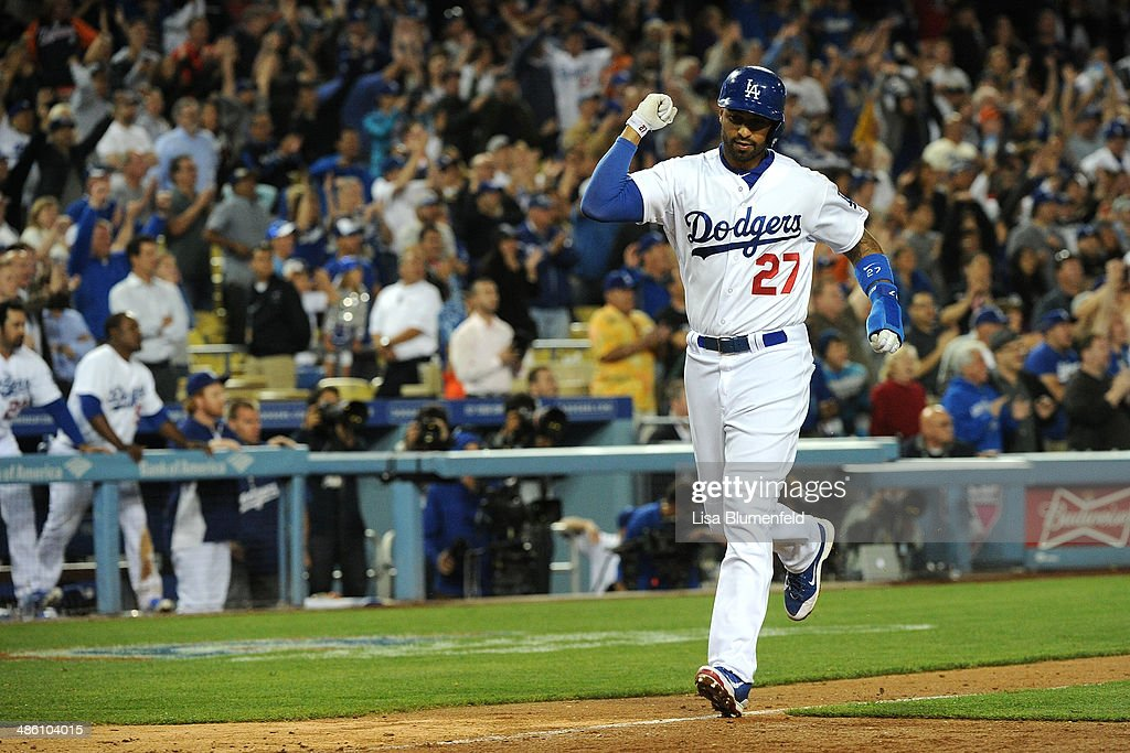 Matt Kemp #27 of the Los Angeles Dodgers celebrates as he scores on the ninth inning against the Detroit Tigers at Dodger Stadium on April 9, 2014 in Los Angeles, California.