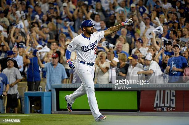 Matt Kemp of the Los Angeles Dodgers celebrates hitting a solo homerun to lead off and take a 32 lead in the eighth inning of Game Two of the...