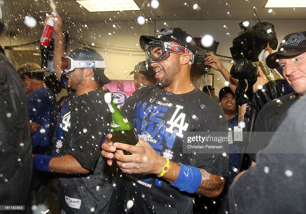 <a gi-track='captionPersonalityLinkClicked' href=/galleries/search?phrase=Matt+Kemp&family=editorial&specificpeople=567161 ng-click='$event.stopPropagation()'>Matt Kemp</a> #27 of the Los Angeles Dodgers celebrates in the locker room after defeating the Arizona Diamondbacks to clinch the National League West title and a postseason berth at Chase Field on September 19, 2013 in Phoenix, Arizona.