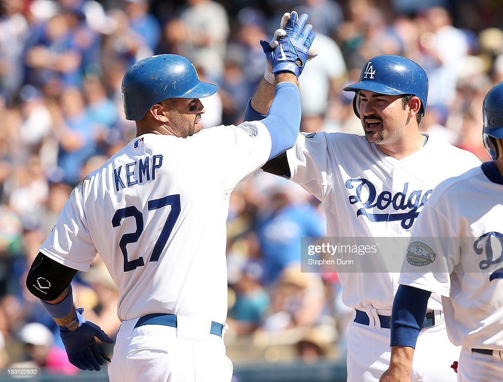 Matt Kemp #27 of the Los Angeles Dodgers celebrates with on deck hitter Adrian Gonzalez #23 as he scores on his two run home run in the fourth inning against the Colorado Rockies on September 30, 2012 at Dodger Stadium in Los Angeles, California.