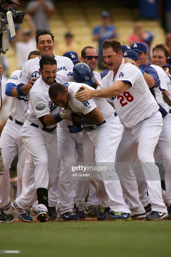 <a gi-track='captionPersonalityLinkClicked' href=/galleries/search?phrase=Matt+Kemp&family=editorial&specificpeople=567161 ng-click='$event.stopPropagation()'>Matt Kemp</a> #27 of the Los Angeles Dodgers celebrates with teammates (l-r) Luis Cruz #47, <a gi-track='captionPersonalityLinkClicked' href=/galleries/search?phrase=Andre+Ethier&family=editorial&specificpeople=543213 ng-click='$event.stopPropagation()'>Andre Ethier</a> #16 and winning pitcher <a gi-track='captionPersonalityLinkClicked' href=/galleries/search?phrase=Jamey+Wright+-+Baseball+Player&family=editorial&specificpeople=220683 ng-click='$event.stopPropagation()'>Jamey Wright</a> #28 after he hit a walk-off two-run home run to right center field against the Philadelphia Phillies in the 12th inning to win the game 5-3 at Dodger Stadium on July 18, 2012 in Los Angeles, California.