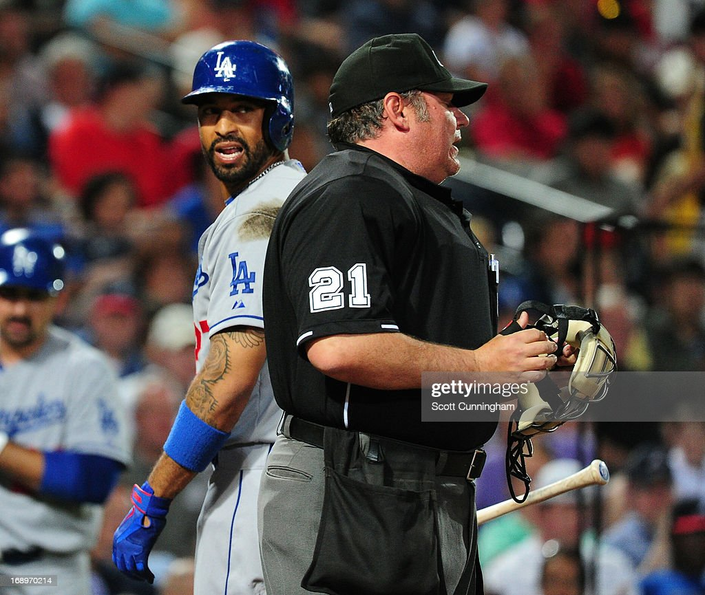 <a gi-track='captionPersonalityLinkClicked' href=/galleries/search?phrase=Matt+Kemp&family=editorial&specificpeople=567161 ng-click='$event.stopPropagation()'>Matt Kemp</a> #27 of the Los Angeles Dodgers disputes a called third strike by umpire <a gi-track='captionPersonalityLinkClicked' href=/galleries/search?phrase=Hunter+Wendelstedt&family=editorial&specificpeople=171442 ng-click='$event.stopPropagation()'>Hunter Wendelstedt</a> during the game against the Atlanta Braves at Turner Field on May 17, 2013 in Atlanta, Georgia.