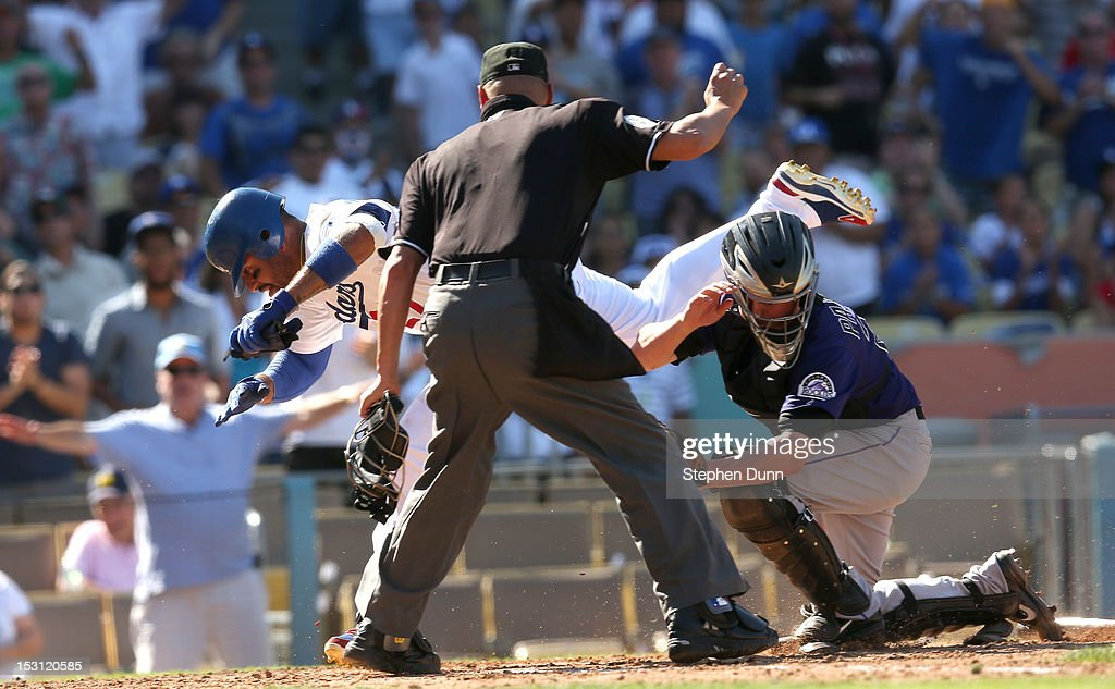<a gi-track='captionPersonalityLinkClicked' href=/galleries/search?phrase=Matt+Kemp&family=editorial&specificpeople=567161 ng-click='$event.stopPropagation()'>Matt Kemp</a> #27 of the Los Angeles Dodgers falls over catcher Jordan Pacheco #22 of the Colorado Rockies after they collide at home plate as home plate umpire Vic Carapazza makes the out call to end the fifth inning on September 30, 2012 at Dodger Stadium in Los Angeles, California.