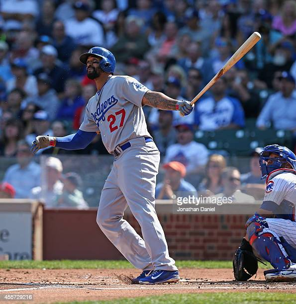 Matt Kemp of the Los Angeles Dodgers follows the flight of his threerun home run in the 1st inning against the Chicago Cubs at Wrigley Field on...