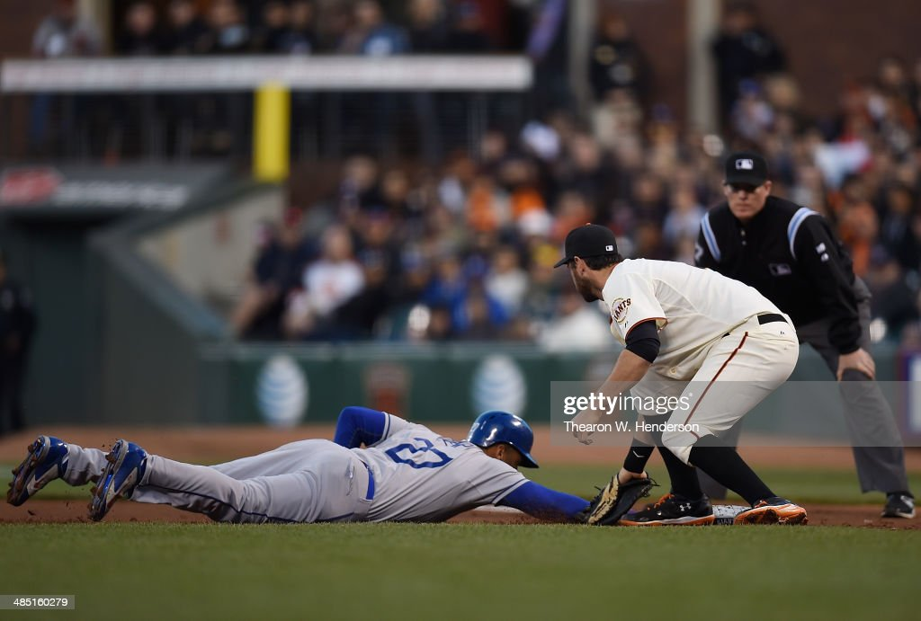 <a gi-track='captionPersonalityLinkClicked' href=/galleries/search?phrase=Matt+Kemp&family=editorial&specificpeople=567161 ng-click='$event.stopPropagation()'>Matt Kemp</a> #27 of the Los Angeles Dodgers gets picked-off of first base tagged out by <a gi-track='captionPersonalityLinkClicked' href=/galleries/search?phrase=Brandon+Belt&family=editorial&specificpeople=7513394 ng-click='$event.stopPropagation()'>Brandon Belt</a> #9 of the San Francisco Giants in the top of the second inning at AT&T Park on April 16, 2014 in San Francisco, California. The Dodgers challanged the out call.