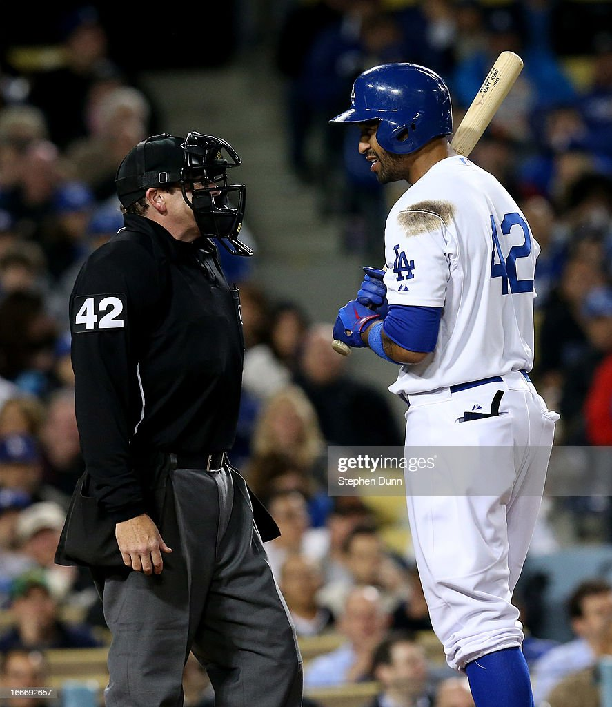 <a gi-track='captionPersonalityLinkClicked' href=/galleries/search?phrase=Matt+Kemp&family=editorial&specificpeople=567161 ng-click='$event.stopPropagation()'>Matt Kemp</a> of the Los Angeles Dodgers has a word with home plate umpire Paul Schrieber after being called out on stirkes in the seventh inning against the San Diego Padres at Dodger Stadium on April 15, 2013 in Los Angeles, California. All uniformed team members are wearing jersey number 42 in honor of Jackie Robinson Day.