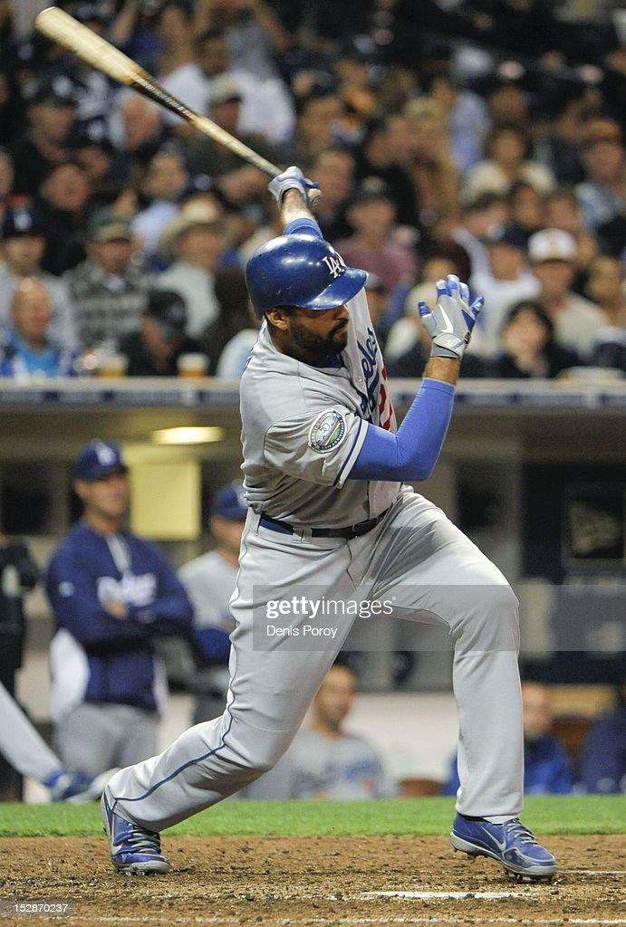 <a gi-track='captionPersonalityLinkClicked' href=/galleries/search?phrase=Matt+Kemp&family=editorial&specificpeople=567161 ng-click='$event.stopPropagation()'>Matt Kemp</a> #27 of the Los Angeles Dodgers hits a double during the fifth inning of a baseball game against the San Diego Padres at Petco Park on September 27, 2012 in San Diego, California.