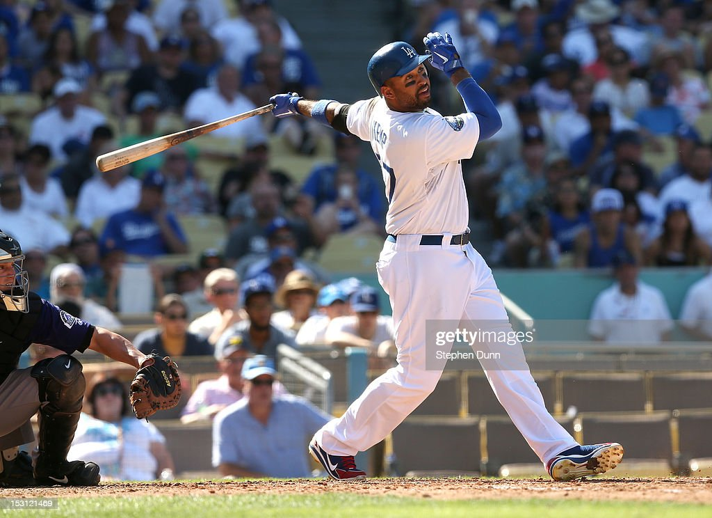 <a gi-track='captionPersonalityLinkClicked' href=/galleries/search?phrase=Matt+Kemp&family=editorial&specificpeople=567161 ng-click='$event.stopPropagation()'>Matt Kemp</a> #27 of the Los Angeles Dodgers hits a single in the fifth inning against the Colorado Rockies on September 30, 2012 at Dodger Stadium in Los Angeles, California. The Dodgers won 7-1.