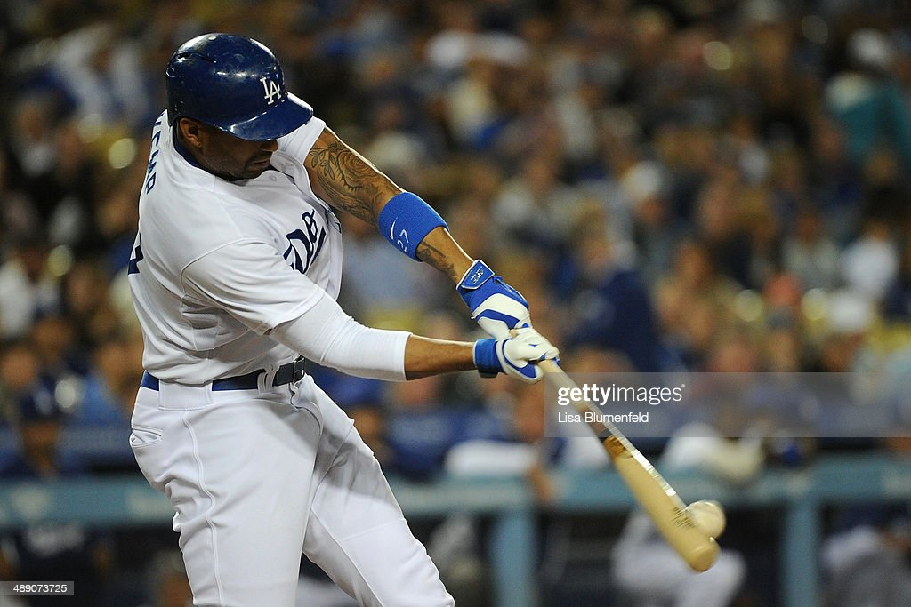 <a gi-track='captionPersonalityLinkClicked' href=/galleries/search?phrase=Matt+Kemp&family=editorial&specificpeople=567161 ng-click='$event.stopPropagation()'>Matt Kemp</a> #27 of the Los Angeles Dodgers hits a single in the fourth inning against the San Francisco Giants at Dodger Stadium on May 9, 2014 in Los Angeles, California.