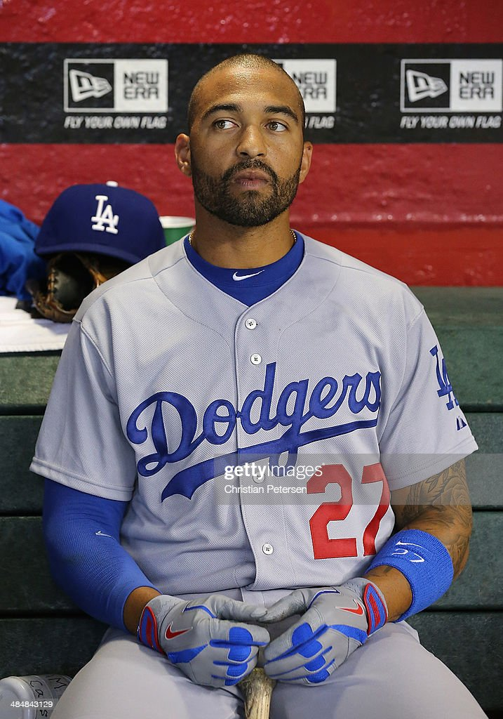 Matt Kemp #27 of the Los Angeles Dodgers in the dugout before the MLB game against the Arizona Diamondbacks at Chase Field on April 13, 2014 in Phoenix, Arizona. The Dodgers defeated the Diamondbacks 8-6.