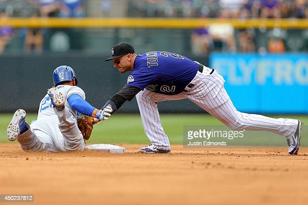 Matt Kemp of the Los Angeles Dodgers is caught trying to stretch a single into a double as Troy Tulowitzki of the Colorado Rockies applies the tag...