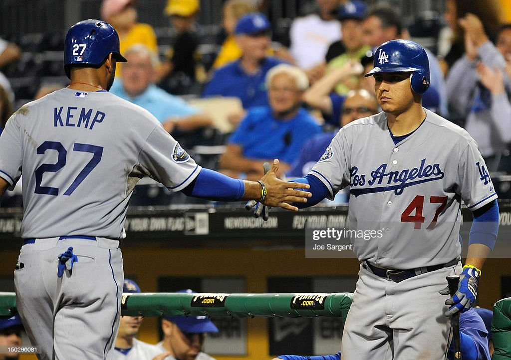<a gi-track='captionPersonalityLinkClicked' href=/galleries/search?phrase=Matt+Kemp&family=editorial&specificpeople=567161 ng-click='$event.stopPropagation()'>Matt Kemp</a> #27 of the Los Angeles Dodgers is congratulated by Luis Cruz #47 after scoring in the fourth inning against the Pittsburgh Pirates on August 14, 2012 at PNC Park in Pittsburgh, Pennsylvania. Los Angeles won the game 11-0.