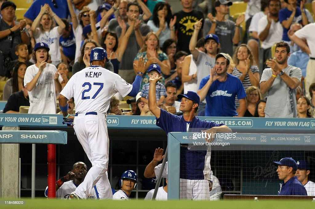 <a gi-track='captionPersonalityLinkClicked' href=/galleries/search?phrase=Matt+Kemp&family=editorial&specificpeople=567161 ng-click='$event.stopPropagation()'>Matt Kemp</a> #27 of the Los Angeles Dodgers is congratulated by manager <a gi-track='captionPersonalityLinkClicked' href=/galleries/search?phrase=Don+Mattingly&family=editorial&specificpeople=204707 ng-click='$event.stopPropagation()'>Don Mattingly</a> after Kemp scored on a ground rule double to deep right by Juan Uribe #5 (not in photo) in the sixth inning against the New York Mets during the MLB game at Dodger Stadium on July 7, 2011 in Los Angeles, California.