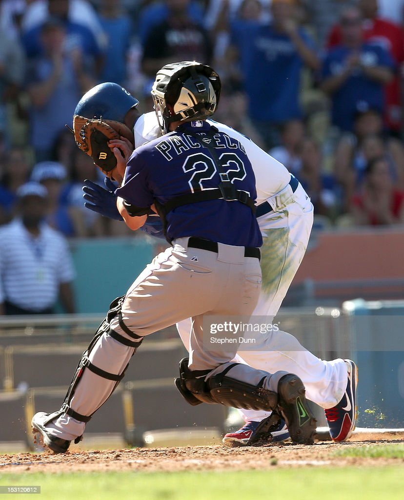 <a gi-track='captionPersonalityLinkClicked' href=/galleries/search?phrase=Matt+Kemp&family=editorial&specificpeople=567161 ng-click='$event.stopPropagation()'>Matt Kemp</a> #27 of the Los Angeles Dodgers is tagged out as he collides with catcher Jordan Pacheco #22 of the Colorado Rockies trying to score in the fifth inning on September 30, 2012 at Dodger Stadium in Los Angeles, California.