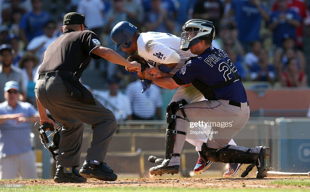 <a gi-track='captionPersonalityLinkClicked' href=/galleries/search?phrase=Matt+Kemp&family=editorial&specificpeople=567161 ng-click='$event.stopPropagation()'>Matt Kemp</a> #27 of the Los Angeles Dodgers is tagged out as he collides with catcher Jordan Pacheco #22 of the Colorado Rockies trying to score in the fifth inningas home plate umpire Vic Carapazza looks to make the call on September 30, 2012 at Dodger Stadium in Los Angeles, California.