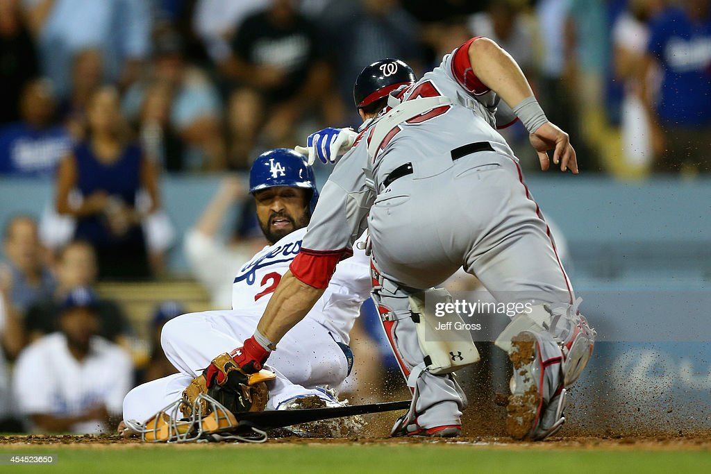 <a gi-track='captionPersonalityLinkClicked' href=/galleries/search?phrase=Matt+Kemp&family=editorial&specificpeople=567161 ng-click='$event.stopPropagation()'>Matt Kemp</a> #27 of the Los Angeles Dodgers is tagged out at home by catcher <a gi-track='captionPersonalityLinkClicked' href=/galleries/search?phrase=Wilson+Ramos&family=editorial&specificpeople=4866956 ng-click='$event.stopPropagation()'>Wilson Ramos</a> #40 of the Washington Nationals in the fourth inning at Dodger Stadium on September 2, 2014 in Los Angeles, California.