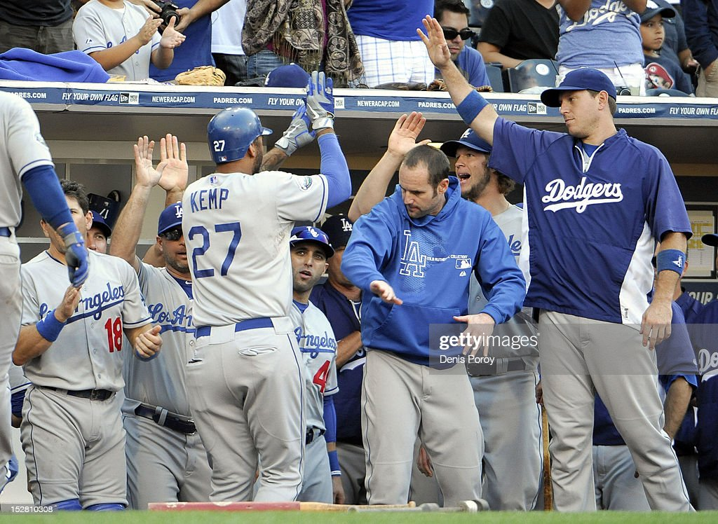 <a gi-track='captionPersonalityLinkClicked' href=/galleries/search?phrase=Matt+Kemp&family=editorial&specificpeople=567161 ng-click='$event.stopPropagation()'>Matt Kemp</a> #27 of the Los Angeles Dodgers is welcomed into the dugout after hitting a two-run homer during the sixth inning of a baseball game against the San Diego Padres at Petco Park on September 26, 2012 in San Diego, California.