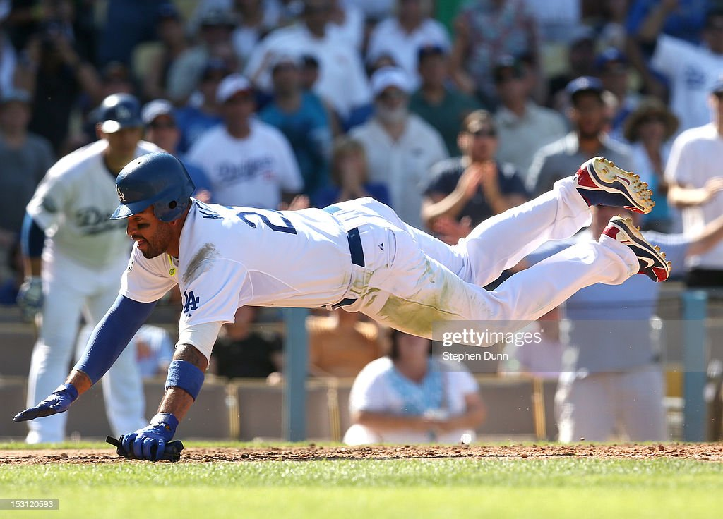 <a gi-track='captionPersonalityLinkClicked' href=/galleries/search?phrase=Matt+Kemp&family=editorial&specificpeople=567161 ng-click='$event.stopPropagation()'>Matt Kemp</a> #27 of the Los Angeles Dodgers lands after colliding with catcher Jordan Pacheco #22 of the Colorado Rockies as he is out trying to score in the fifth inning on September 30, 2012 at Dodger Stadium in Los Angeles, California.