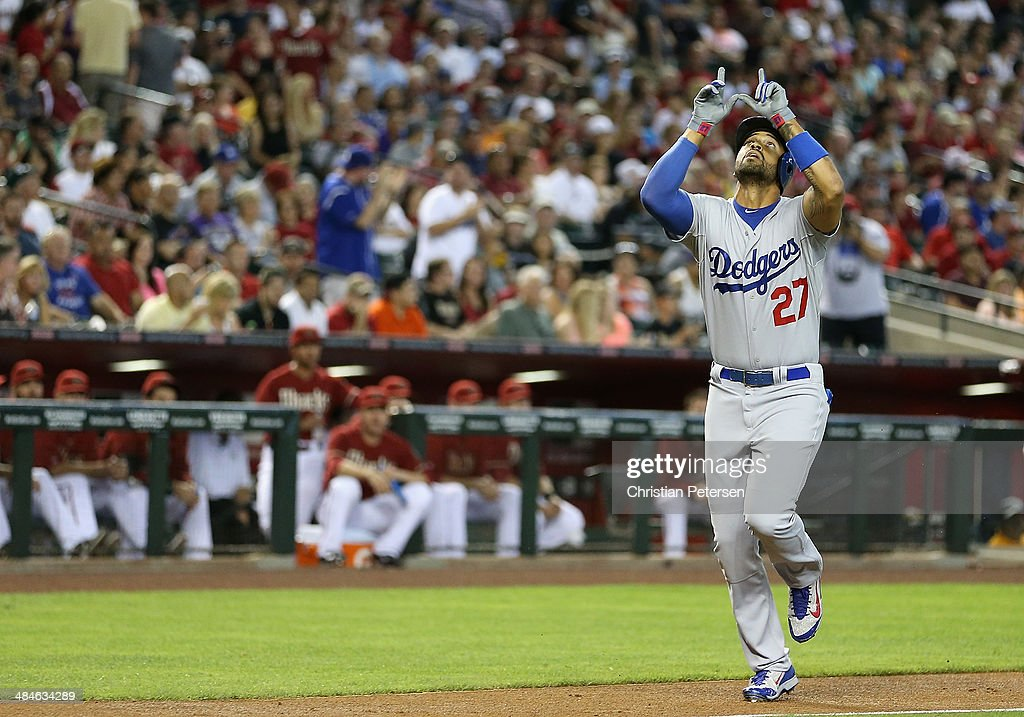 Matt Kemp #27 of the Los Angeles Dodgers points to the sky after hitting a solo home-run against the Arizona Diamondbacks during the second inning of the MLB game at Chase Field on April 13, 2014 in Phoenix, Arizona.