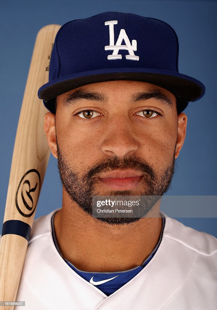 Matt Kemp #27 of the Los Angeles Dodgers poses for a portrait during spring training photo day at Camelback Ranch on February 17, 2013 in Glendale, Arizona.