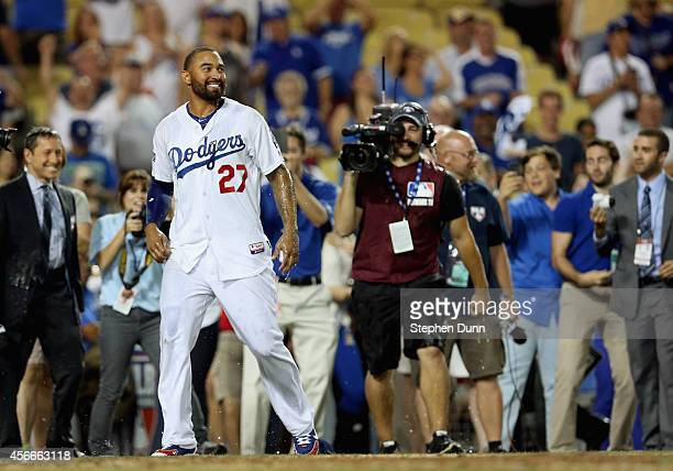 Matt Kemp of the Los Angeles Dodgers reacts in celebration of the 32 win over the St Louis Cardinals in Game Two of the National League Division...