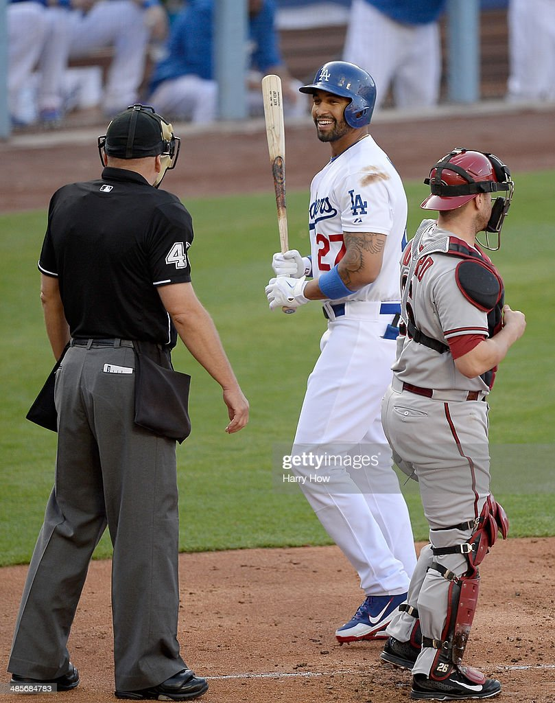 Matt Kemp #27 of the Los Angeles Dodgers reacts in front of Umpire Jeff Nelson and Miguel Montero #26 of the Arizona Diamondbacks after his called strikeout during the second inning at Dodger Stadium on April 19, 2014 in Los Angeles, California.