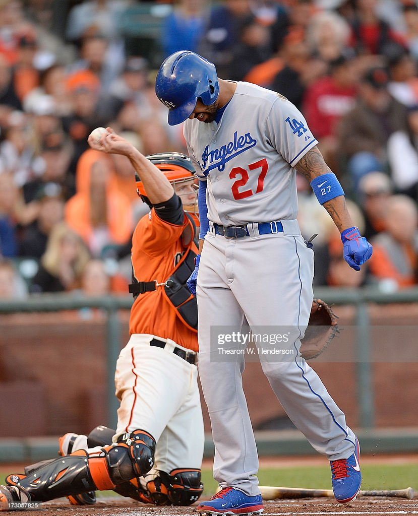 Matt Kemp #27 of the Los Angeles Dodgers reacts to pain in his left shoulder after a swing of the bat in the second inning against the San Francisco Giants at AT&T Park on July 5, 2013 in San Francisco, California. Kemp would come out of the game in the third inning.