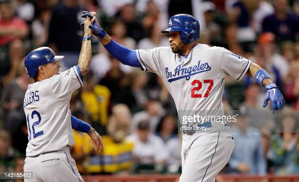Matt Kemp of the Los Angeles Dodgers receives a high five from Justin Sellers after hitting a tworun home run in the first inning against the Houston...