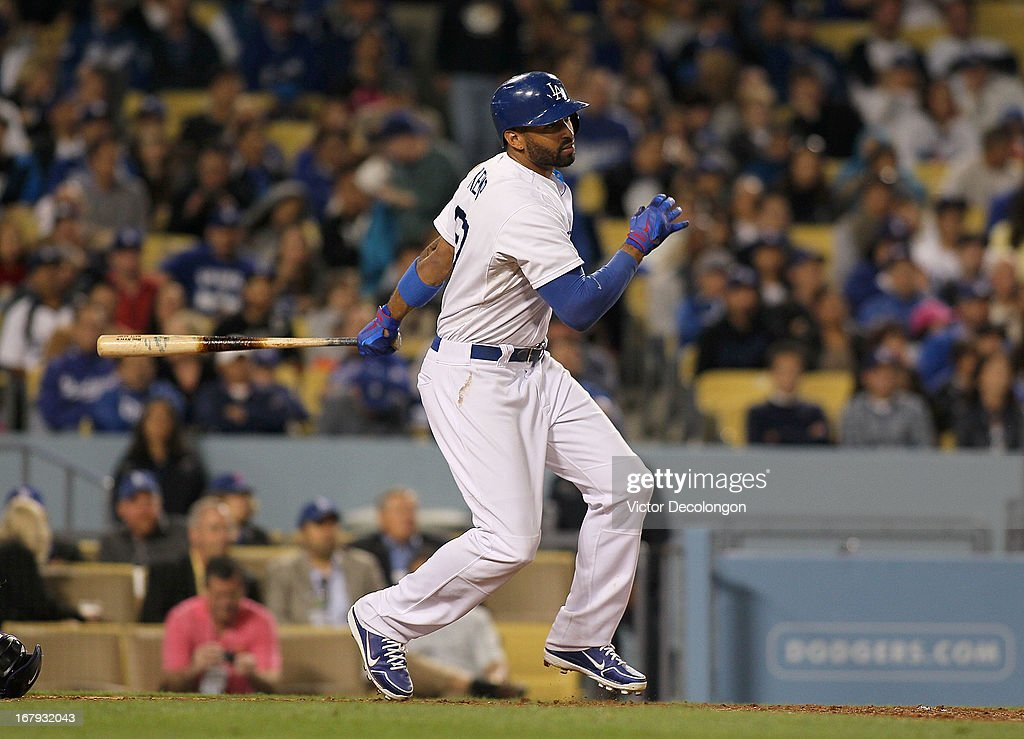 <a gi-track='captionPersonalityLinkClicked' href=/galleries/search?phrase=Matt+Kemp&family=editorial&specificpeople=567161 ng-click='$event.stopPropagation()'>Matt Kemp</a> #27 of the Los Angeles Dodgers singles to right field in the sixth inning against the Colorado Rockies during the MLB game at Dodger Stadium on April 30, 2013 in Los Angeles, California. The Dodgers defeated the Rockies 6-2.