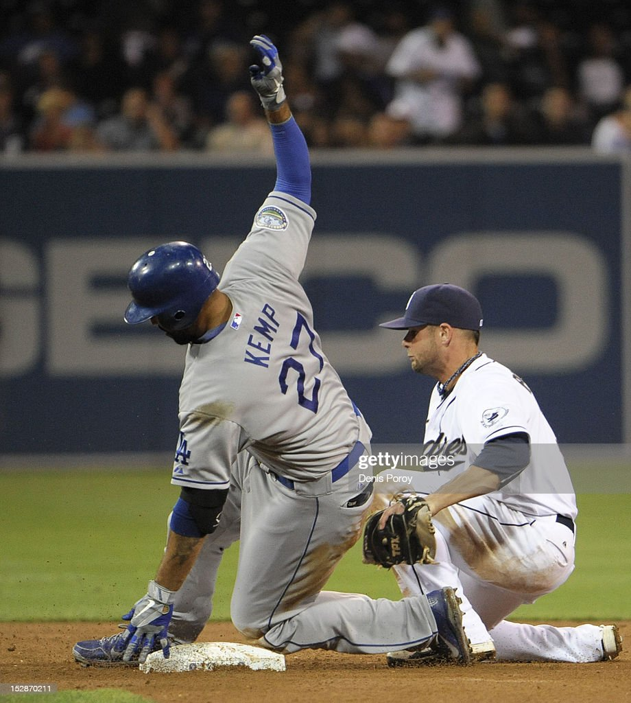 <a gi-track='captionPersonalityLinkClicked' href=/galleries/search?phrase=Matt+Kemp&family=editorial&specificpeople=567161 ng-click='$event.stopPropagation()'>Matt Kemp</a> #27 of the Los Angeles Dodgers slides into second base with a double ahead of the tag of Andy Parrino #3 of the San Diego Padres during the fifth inning of a baseball game against the San Diego Padres at Petco Park on September 27, 2012 in San Diego, California.