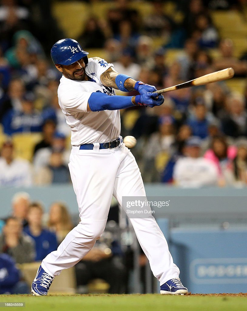Matt Kemp #27 of the Los Angeles Dodgers swings and misses for strike three to make the third out of the eighth inning against the Arizona Diamondbacks at Dodger Stadium on May 8, 2013 in Los Angeles, California.