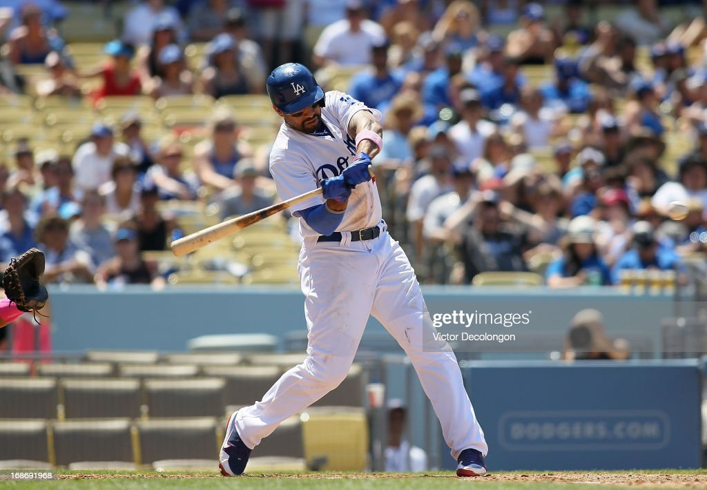 <a gi-track='captionPersonalityLinkClicked' href=/galleries/search?phrase=Matt+Kemp&family=editorial&specificpeople=567161 ng-click='$event.stopPropagation()'>Matt Kemp</a> #27 of the Los Angeles Dodgers swings at pitch in the fifth inning during the MLB game against the Miami Marlins at Dodger Stadium on May 12, 2013 in Los Angeles, California. Kemp hit a broken bat single to center for his 1000th hit on this swing. The Dodgers defeated the Marlins 5-3.
