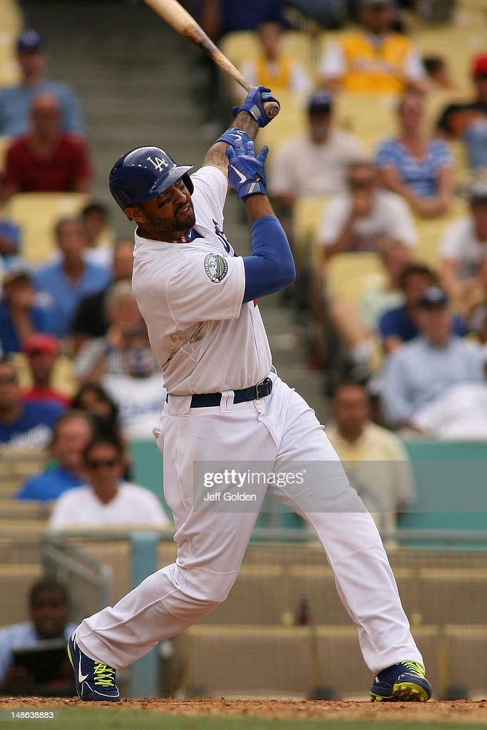 <a gi-track='captionPersonalityLinkClicked' href=/galleries/search?phrase=Matt+Kemp&family=editorial&specificpeople=567161 ng-click='$event.stopPropagation()'>Matt Kemp</a> #27 of the Los Angeles Dodgers watches as he hits a walk-off two-run home run to right center field against the Philadelphia Phillies in the 12th inning to win the game 5-3 at Dodger Stadium on July 18, 2012 in Los Angeles, California.