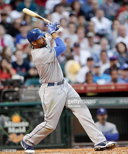Matt Kemp of the Los Angeles Dodgers watches the ball leave the park after hitting a tworun home run in the sixth inning against the Houston Astros...